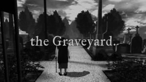 V bráně hřbitova.